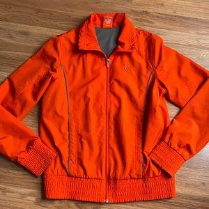 Nike women's orange windbreaker with pockets. M